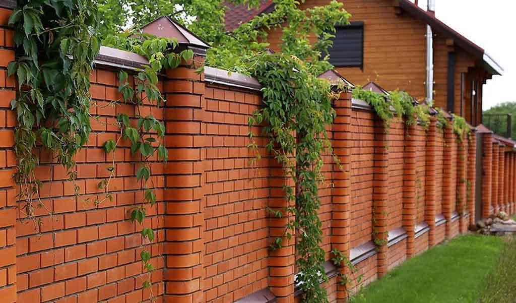 Neat and modern red brick fence