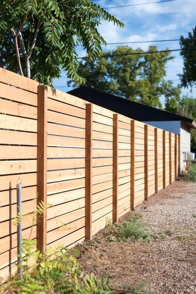 Practical fence made of wooden battens