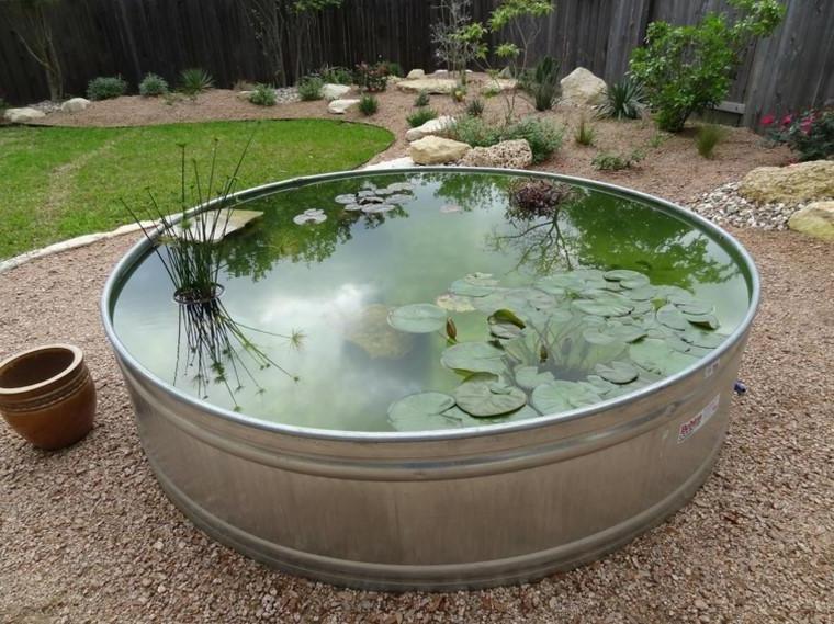 Round shaped steel pond in the garden