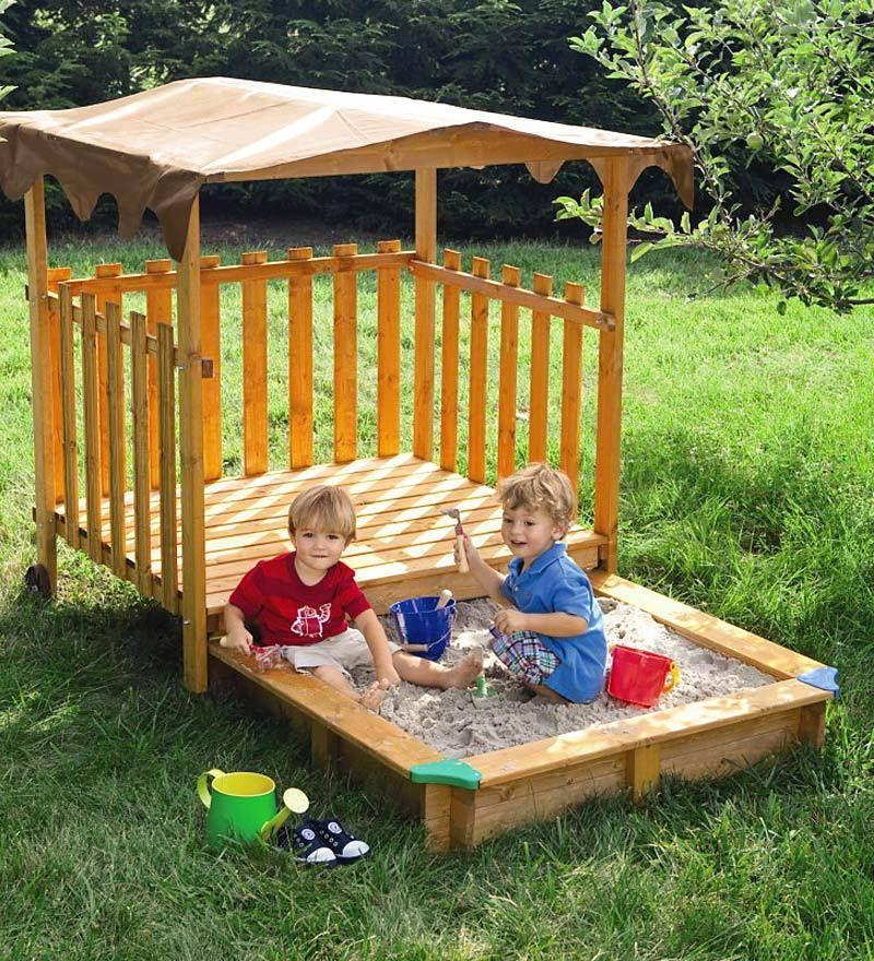 Sandbox with a mobile cover- house