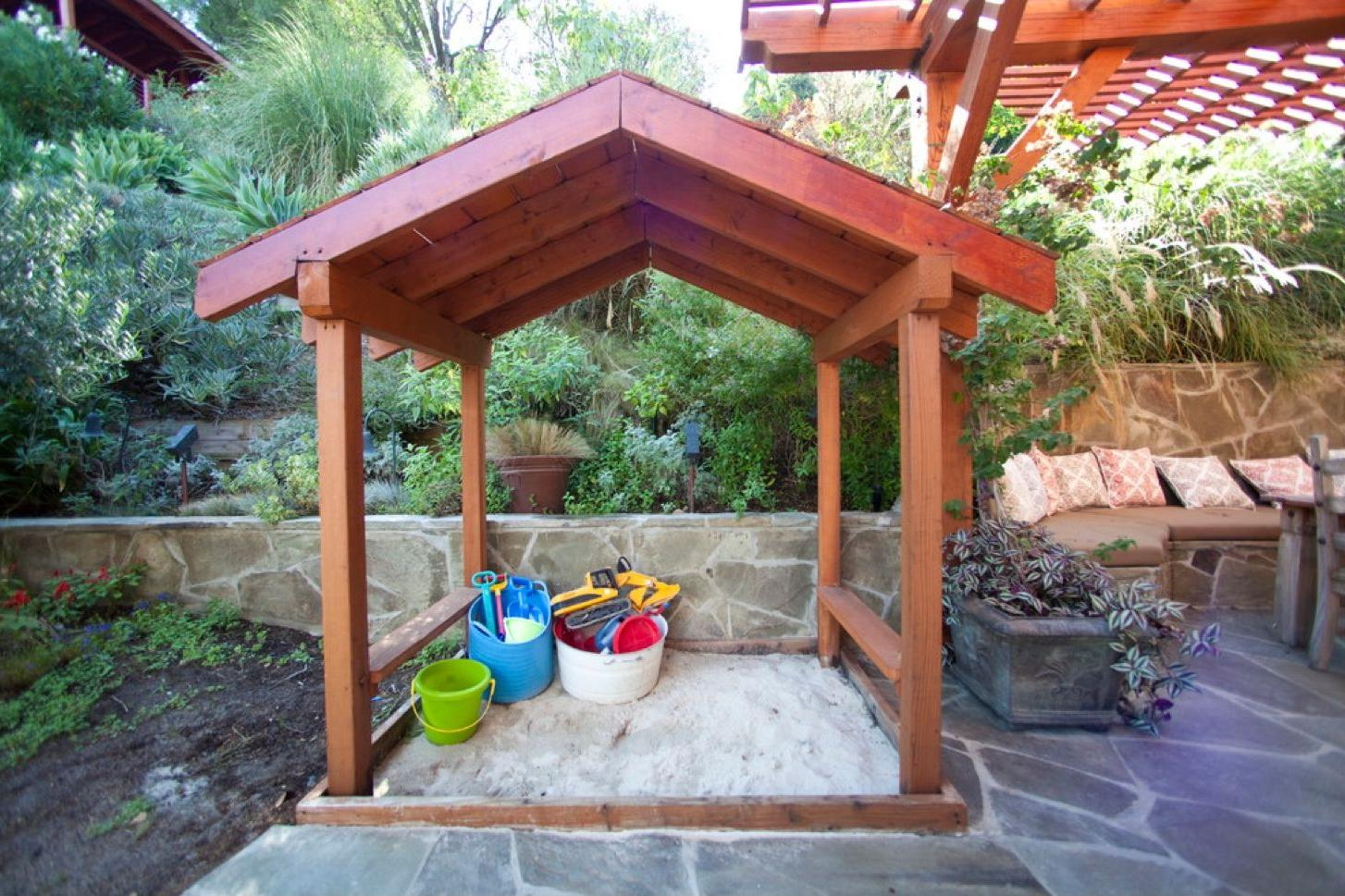 Sandbox with a wooden shed