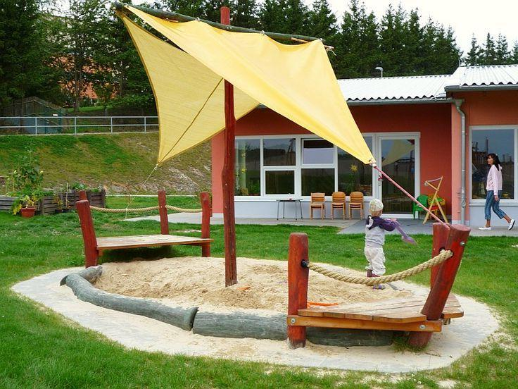 DIY Sandbox with sides, logs and awning, simulating a sail