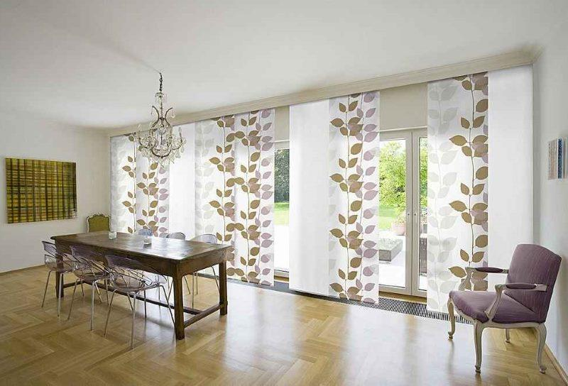 Vertical blinds made of wide fabric stripes with leaf ornament