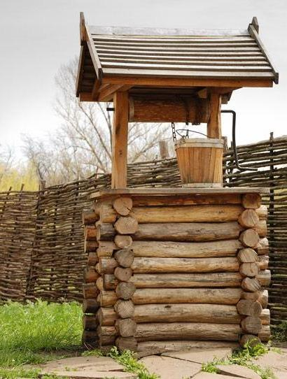 beautiful house for the well will give a highlight of originality and style to your country site