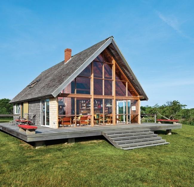 Cozy frame house with a glass facade