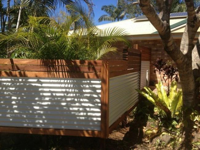 Beautiful fence with a horizontal profiled sheet