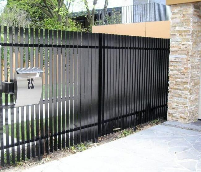 Black metal picket fence