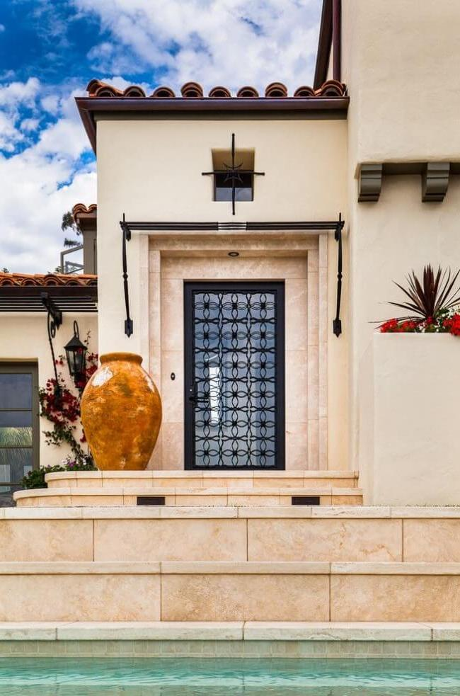 Chic metal door with glass and wrought iron elements
