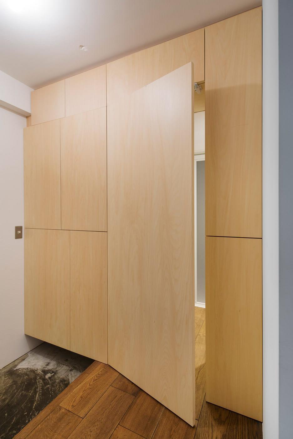 Concealed door with panel
