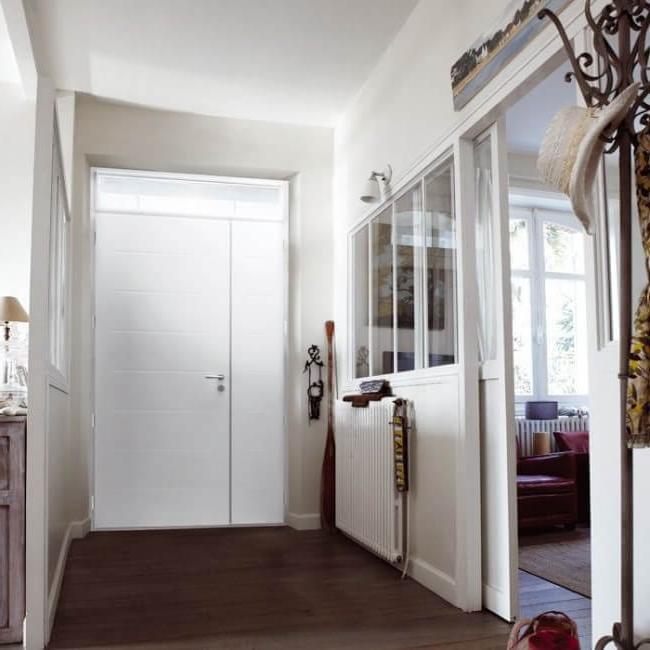 Cozy apartment with white metal door