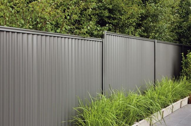 Fence made of beautiful gray profiled metal