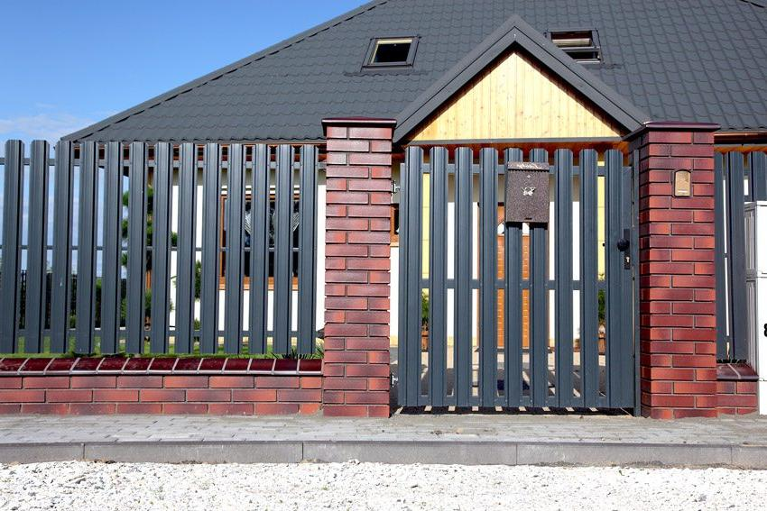 Fence made of metal picket fence with brick posts