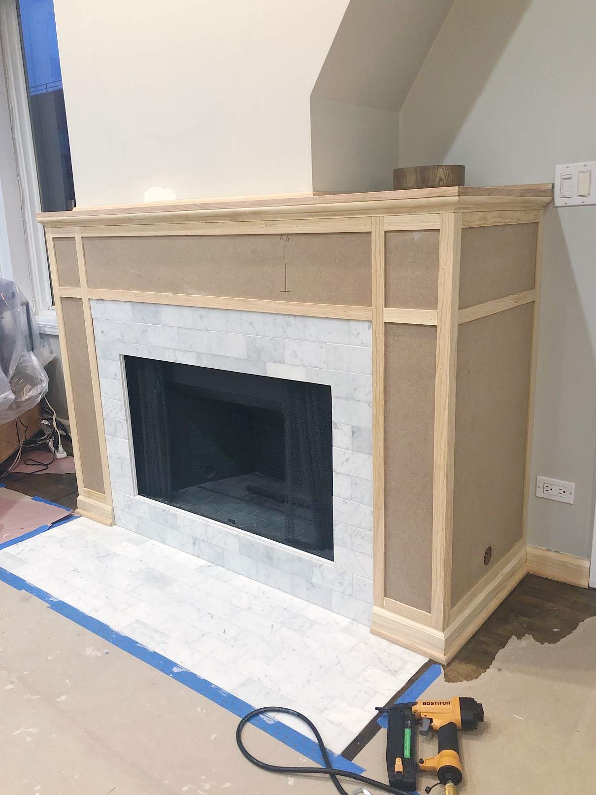 Installing an MDF Mantel Around Marble Fireplace