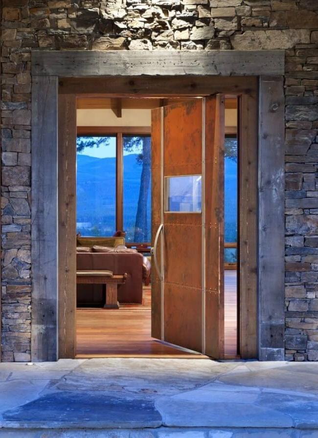 Interesting model of a steel door in rustic style