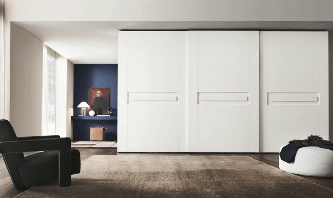 Interior partition in a spacious studio room with a large set of functional segments