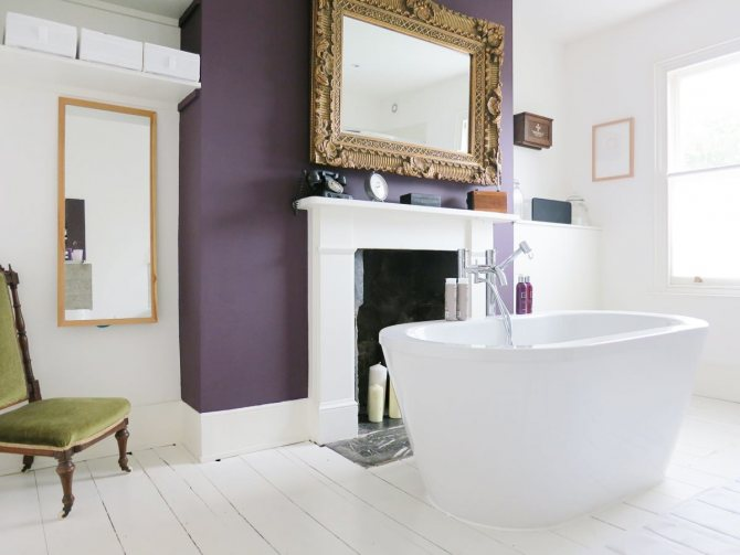 Unique Bathroom Fireplace With White Mantel