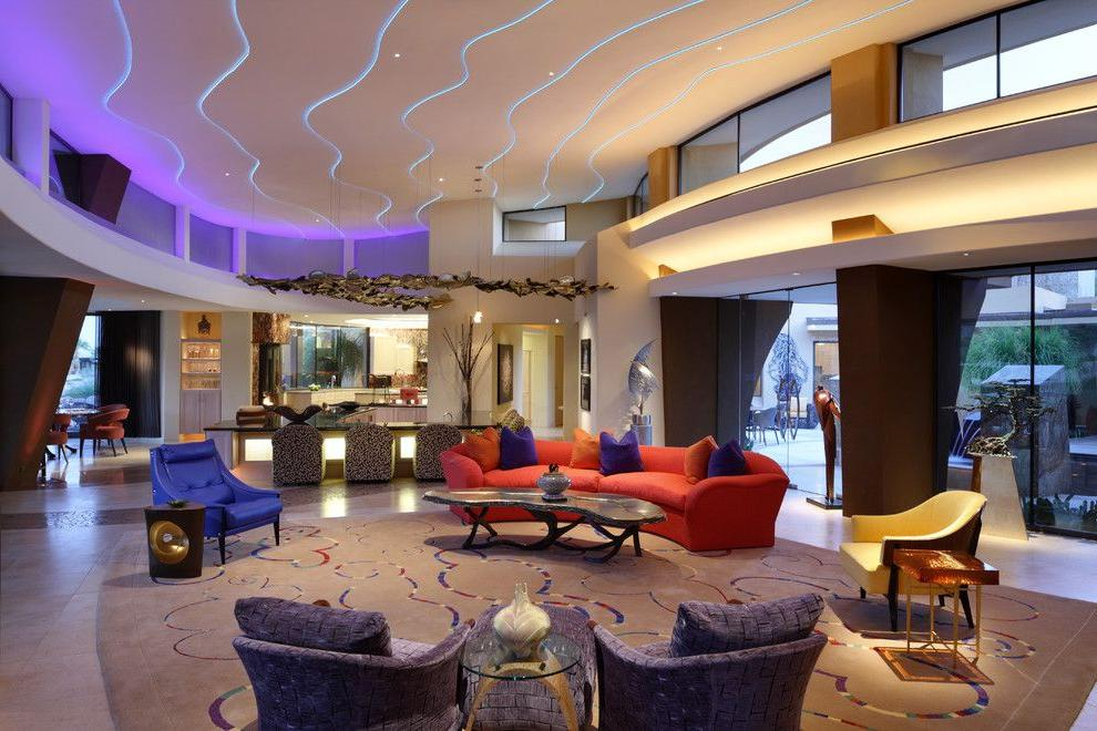 With the help of LED strips, you can clearly highlight the contours of a multi-level ceiling