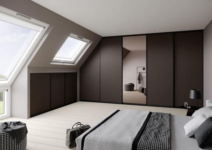 brown wardrobe that occupies one of the walls of the bedroom in the attic