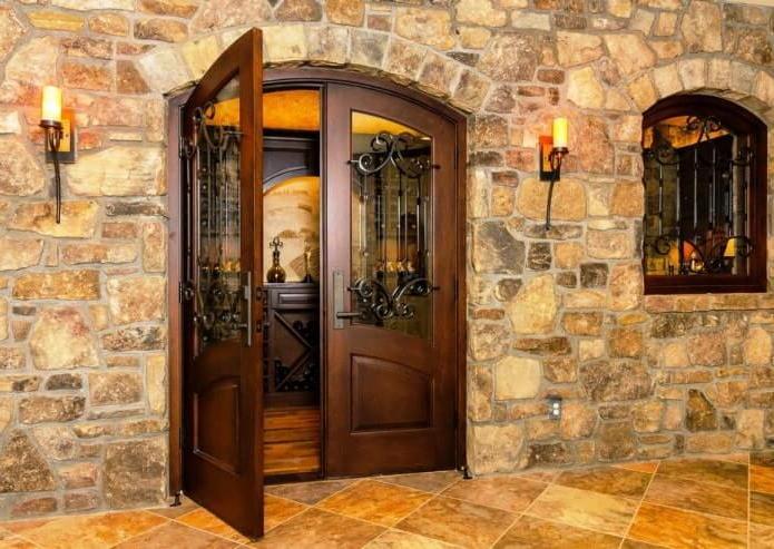oak doors with steel openwork and a glass insert