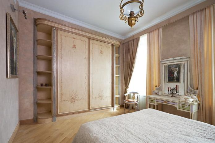 traditional-style bedroom with a wooden wardrobe fitted with side shelves.