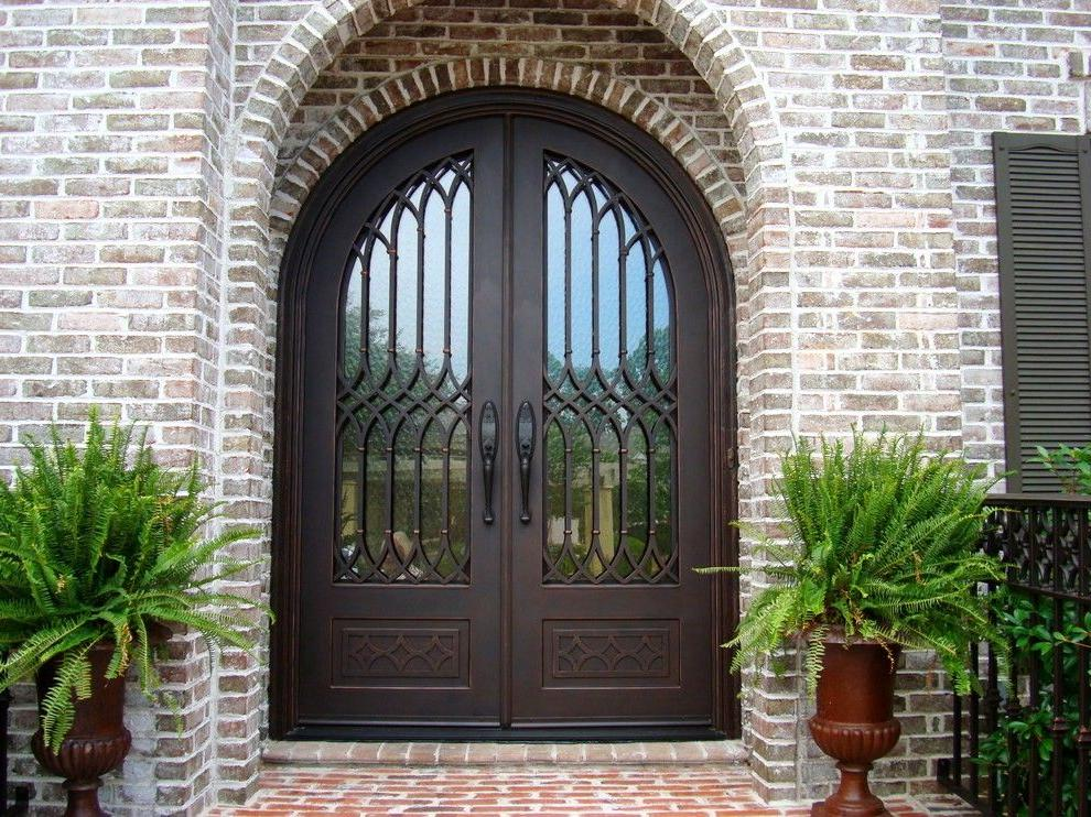 wrought iron and glass front doors