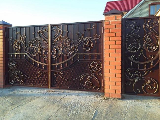 Beautiful metal swing gates with wrought iron elements