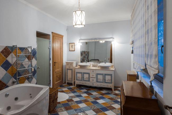 Bright mosaic in a spacious bathroom