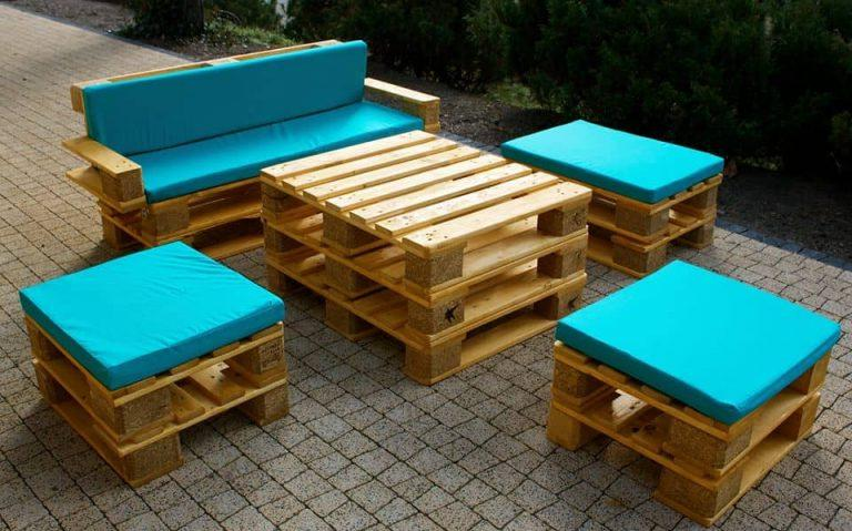 Decorating wooden pallets with colorful pillows will refresh their boring design