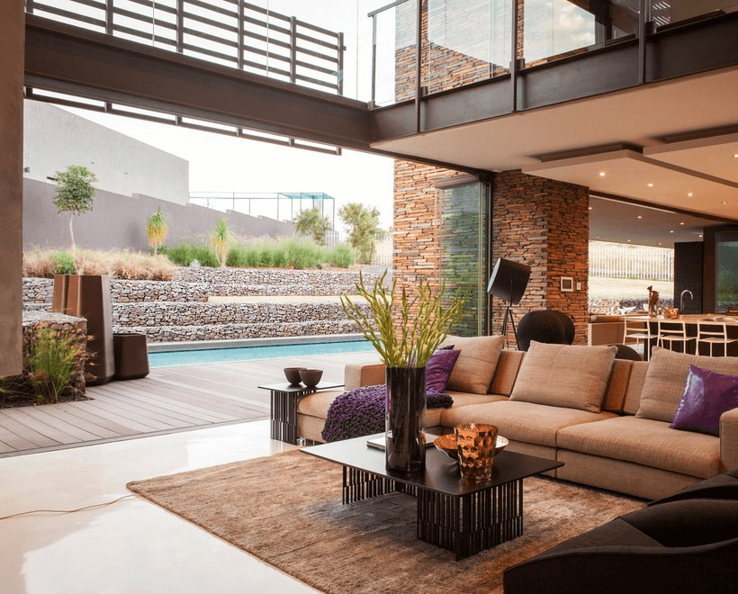 Gabions in the design of the site as a natural continuation of the house, trimmed with natural stone