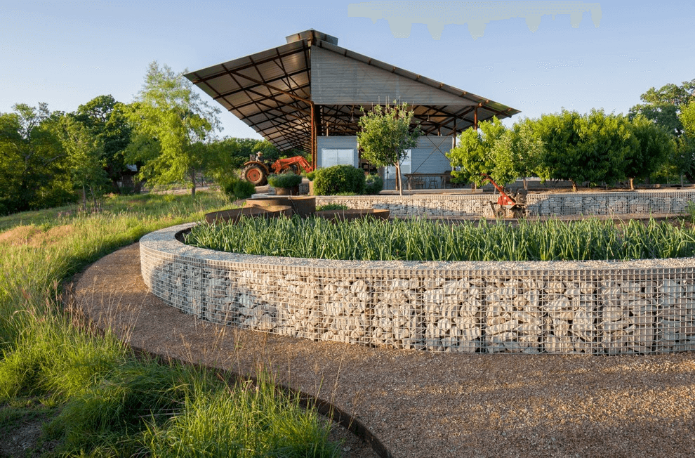 Low gabion structures successfully serve as a fence for flower beds and lawns