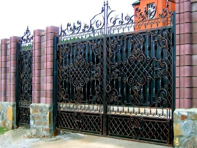 Magnificent wrought-iron swing gates with a wicket