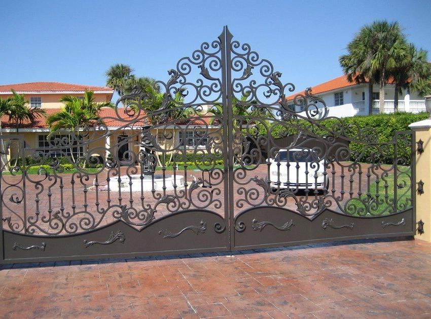 Metal swing gates with an abundance of openwork forged elements