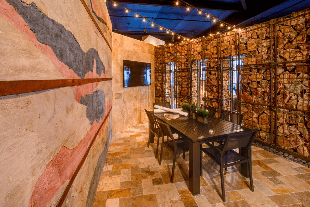 Partitions made of large sharp stones look stylish inside the house, on terraces and verandas.