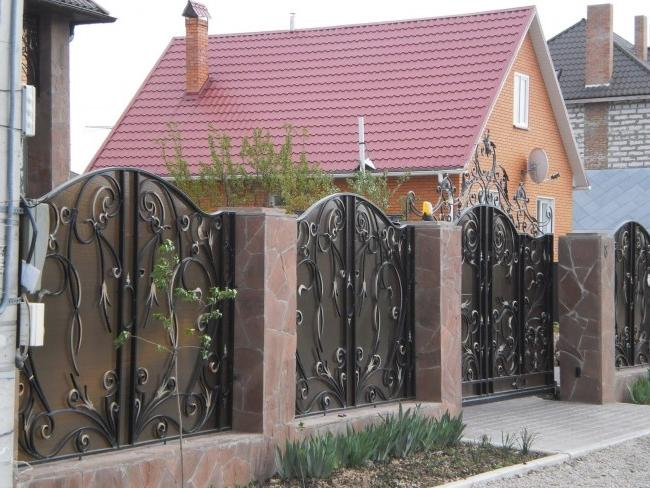 Swing gates and wickets with a wrought-iron pattern