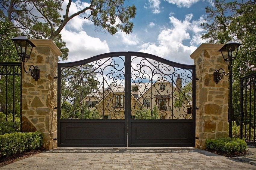 Wrought iron gates and wickets look elegant and luxurious