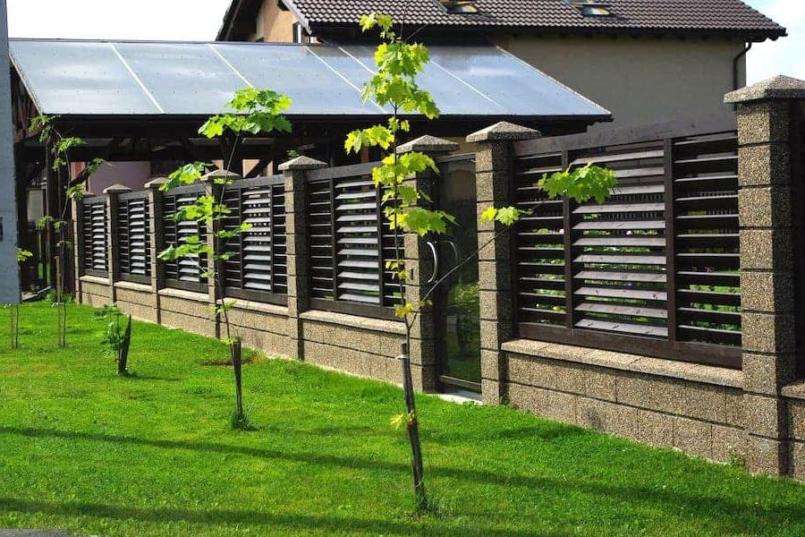 Beautiful combined fence made of wood and stone