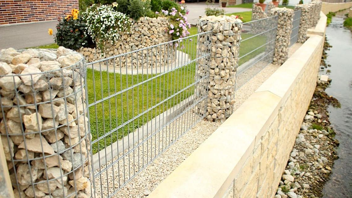 Beautiful decorative fence in a light tone