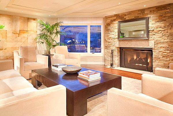 Bright living room with fireplace and mirror.