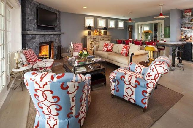 Fireplace with decorative stone trim in the interior of a cozy living room