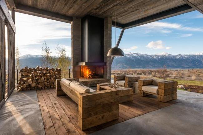 errace with corner fireplace and stunning mountain views
