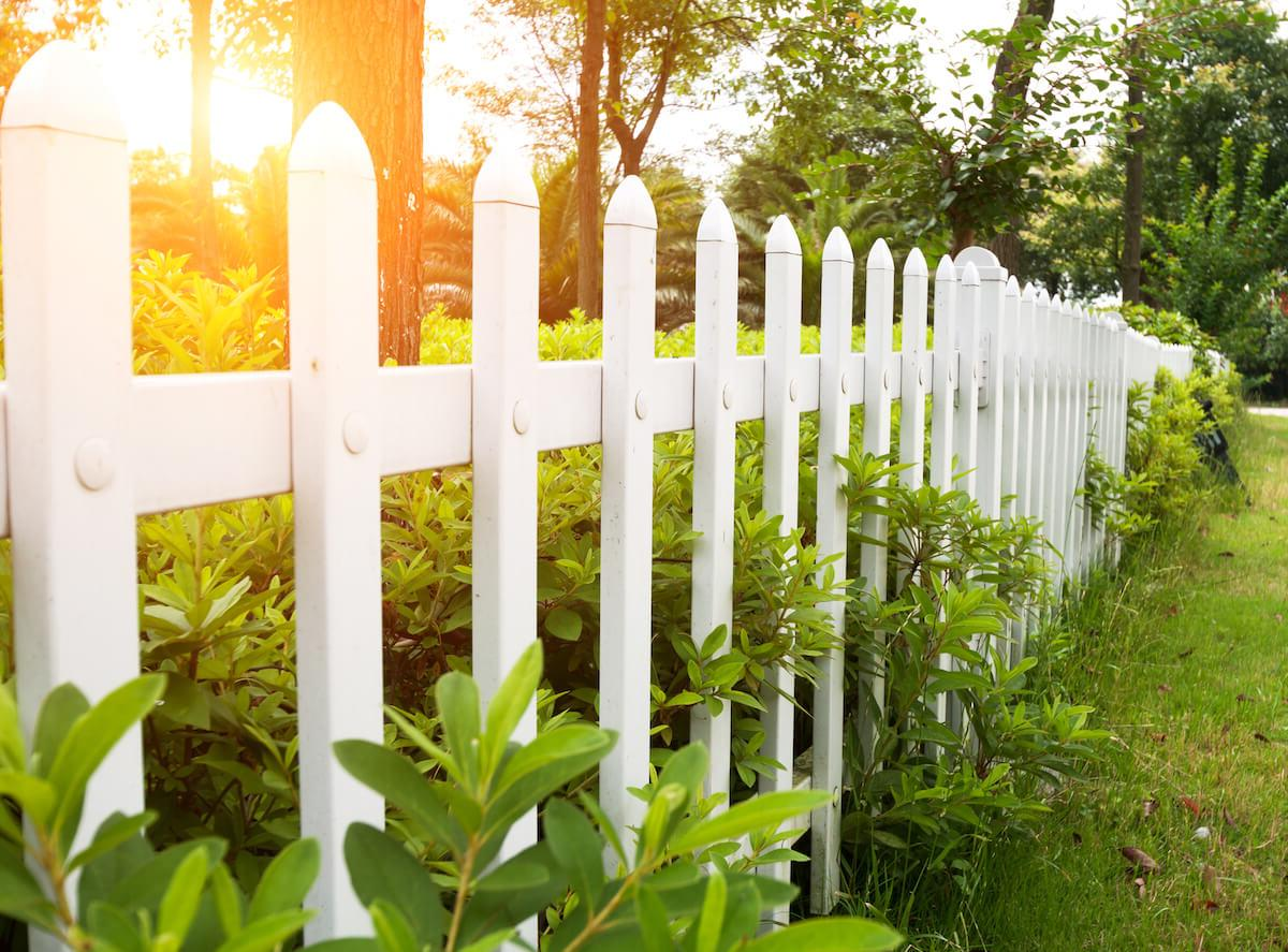 white wooden picket fence